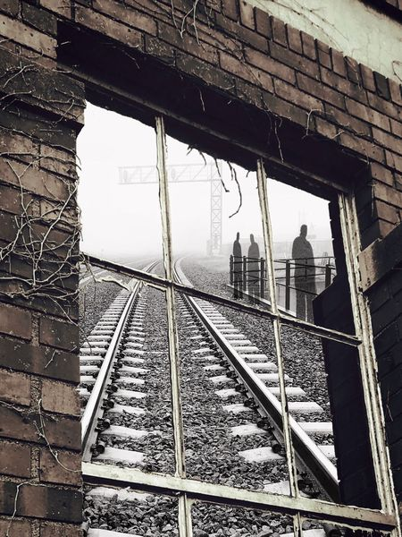 """Waiting on a Train"" Train Track Black And White With Color Black And White Surreal Surrealism Photography Waiting For A Train Art Photograpy Windows Old Building  Reflection Foggy Constructed Artistic Shadows And Light Shadows Railroad Track Transportation Building Exterior The Creative - 2018 EyeEm Awards"