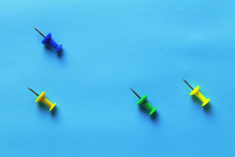High angle view of toy on blue background