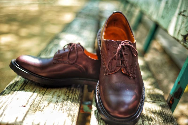 Bokehphotography Selective Focus Focusonforeground Outdoors EyeEm Selects Shoe Brown Leather Pair Close-up No People Focus On Foreground Day Absence Sunlight Outdoors Still Life Clothing Fashion High Angle View Personal Accessory Shoelace Dress Shoe