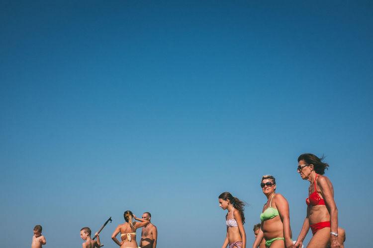 People enjoying in blue sky