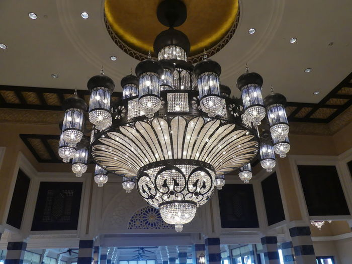 Crystal Chandelier at the Palace Hotel, Dubai, United Arab Emirates 2019 Dubai UAE 2019 Palace Hotel Hotel Arabic Design Crystal Chandelier Chandelier Lighting Equipment Low Angle View Illuminated No People Luxury Hanging Light Fixture Light Ornate Electric Light Decoration Wealth Full Frame Composition Indoor Photography Tourist Destination Ornate Design