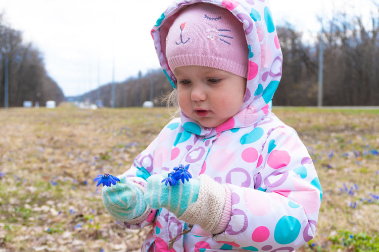 Cute girl wearing hat on field