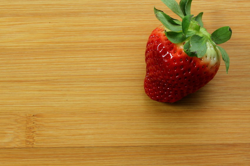Red Shiny Bamboo Background Bamboo Boards Close-up Food Food And Drink Freshness Fruit Healthy Eating Indoors  Leaf No People Ready-to-eat Red Ripe Still Life Strawberry Sweet Food Table