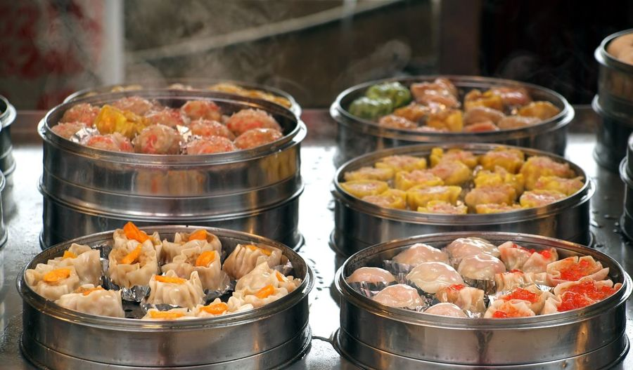 Close-Up Of Chinese Dumplings In Containers