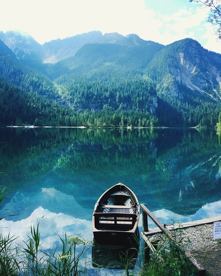 Water Scenics - Nature Beauty In Nature Tree Plant Lake Mountain Nature Tranquil Scene Nautical Vessel Sky Idyllic Mountain Range No People Tranquility