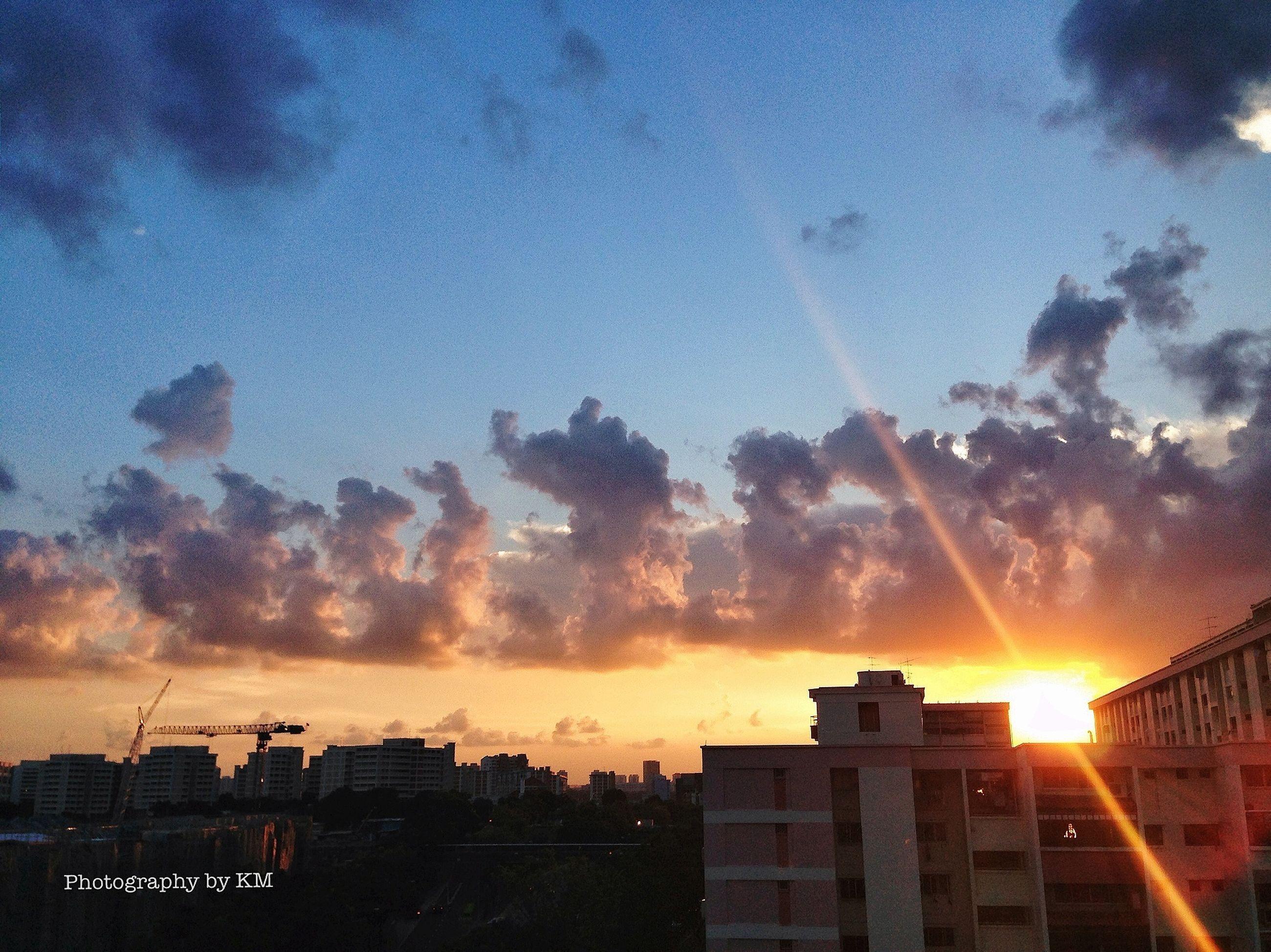 sun, sunset, building exterior, architecture, built structure, sunbeam, sky, sunlight, cloud - sky, lens flare, city, orange color, silhouette, nature, cityscape, beauty in nature, outdoors, scenics, no people, building
