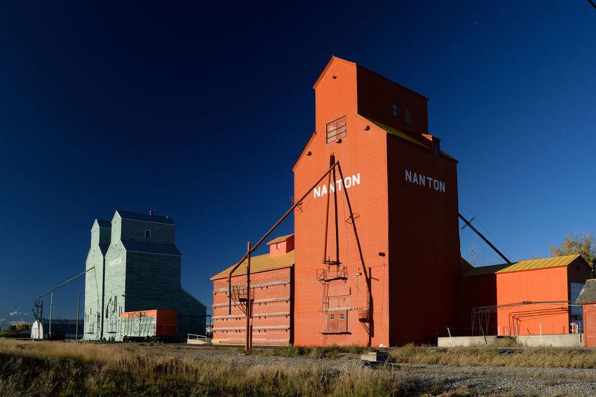 Blue Sky Contrast Contrasting Colors Elevator Farm Life Grain Elevator Heritage Nanton Nanton, Alberta Orange Prairie Prairie Sentinel Railway Rural Scene