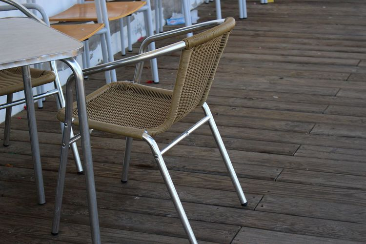 Abstract Photography Chair Outdoor Cafe Terrace Abstract Cafe Chairs Close-up Day Detail Detailphotography Details Details Textures And Shapes Different Different Perspective Hardwood Floor Metal No People Outdoor Chair Outdoors Seat Shadow Stacked Table Wood Paneling