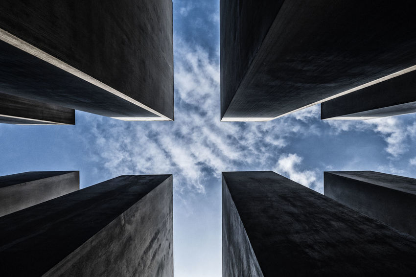 low angle view of Holocaust Memorial in the City of Berlin with Abstract pattern and blue sky background 2nd World War Abstract Pattern Apartment Architectural Feature Architecture Blue Sky Building Building Exterior Built Structure City Cloud - Sky Day Directly Below Holocaust Memorial Berlin Jewish Memorial Low Angle View Modern Nature No People Outdoors Pattern Reflection Second World War Sky Skyscraper Sunlight Tall - High Window