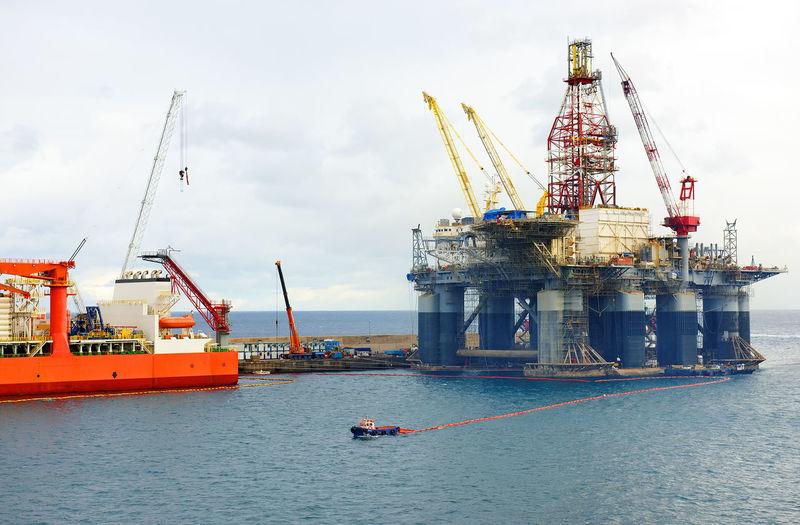 Offshore Platform Amidst Sea Against Sky