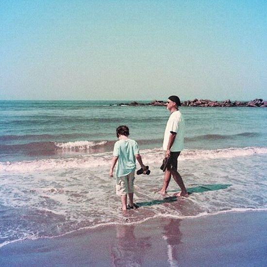 father and son moment in malibu Malibu Father & Son Beach Pacific Ocean California