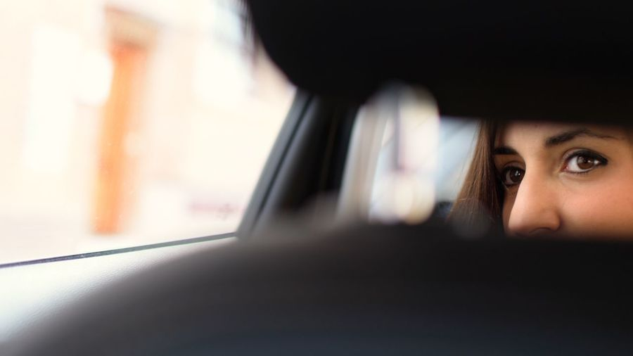 Close-up portrait of woman in car