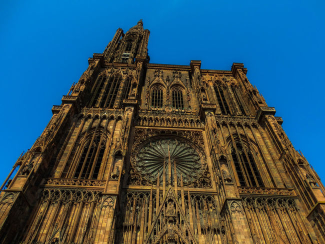 Strasbourg Cathedral Building Exterior Architecture Built Structure Building Low Angle View Sky Religion Nature No People Strasbourg Cathedral Strasbourg Cathedral Architecture Medieval Medieval Architecture Cityscape Sightseeing Travel Destinations Low Angle View Blue Sky