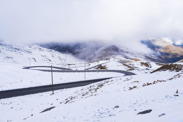 View of passo dello stelvio in snow famous landmark at italy, wallpaper.