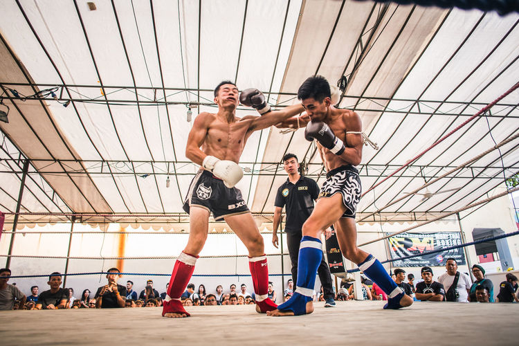 Exchange. Real People Men Sport Shirtless Lifestyles Young Men Healthy Lifestyle Exercising Vitality Young Adult Motion Fighting Muay Thai