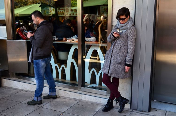 Candid Casual Clothing Caucasian Cellphone City City Life Color Communication Day Device Female Girl Lifestyles Male Man Mobile Person SMS Standing Street Photography Telecommunication The Street Photographer - 2016 EyeEm Awards Using My Mobile Woman Young