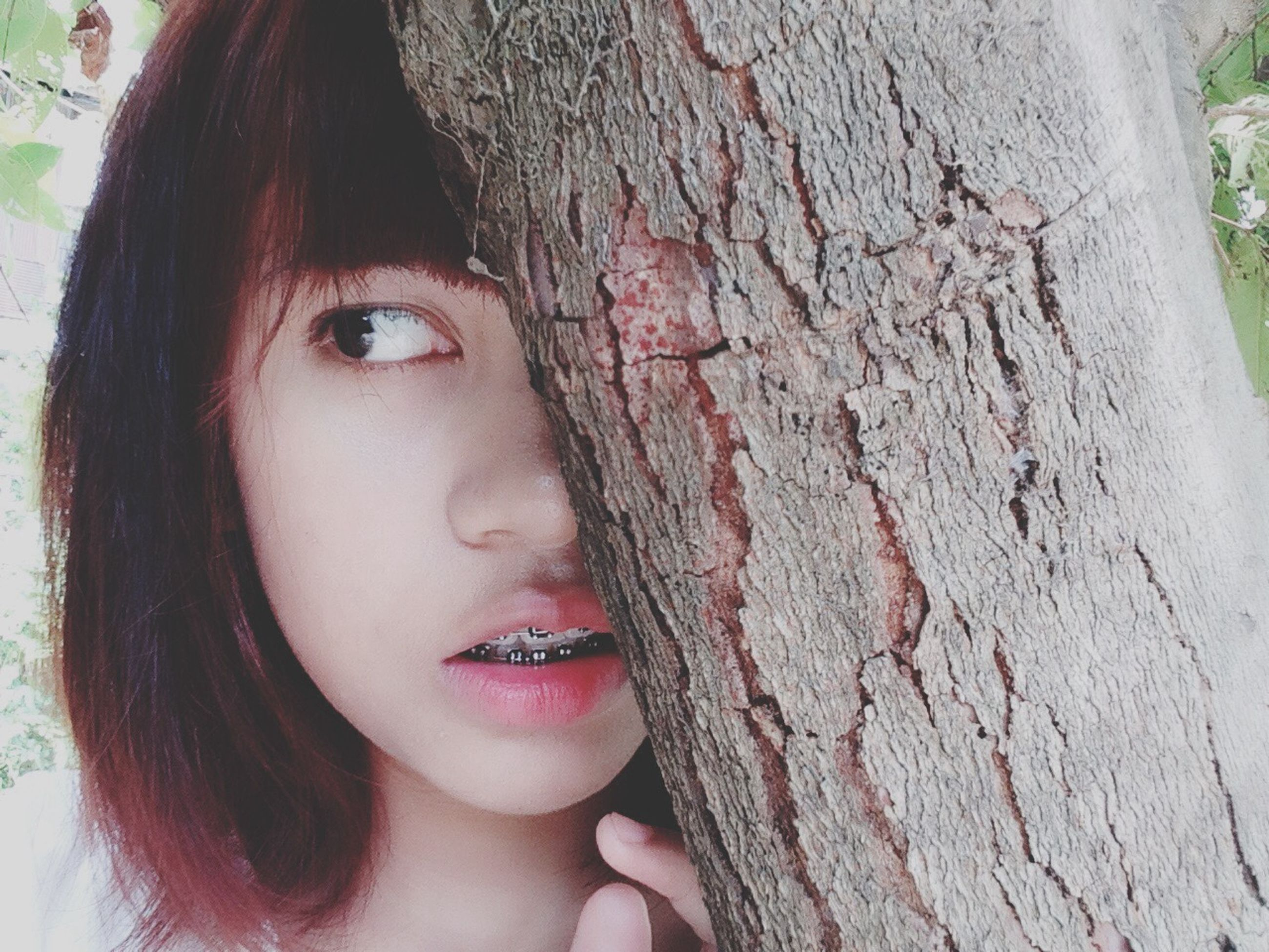 headshot, close-up, portrait, looking at camera, young women, young adult, person, lifestyles, human face, front view, long hair, leisure activity, focus on foreground, tree, tree trunk, part of, beauty