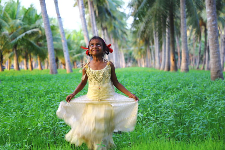 happiness for being captured. Full Length Girl Grass Green Color Happiness Joyful Kids Nature One Woman Only Traditional Clothing Women Around The World The Portraitist - 2017 EyeEm Awards The Portraitist - 2017 EyeEm Awards