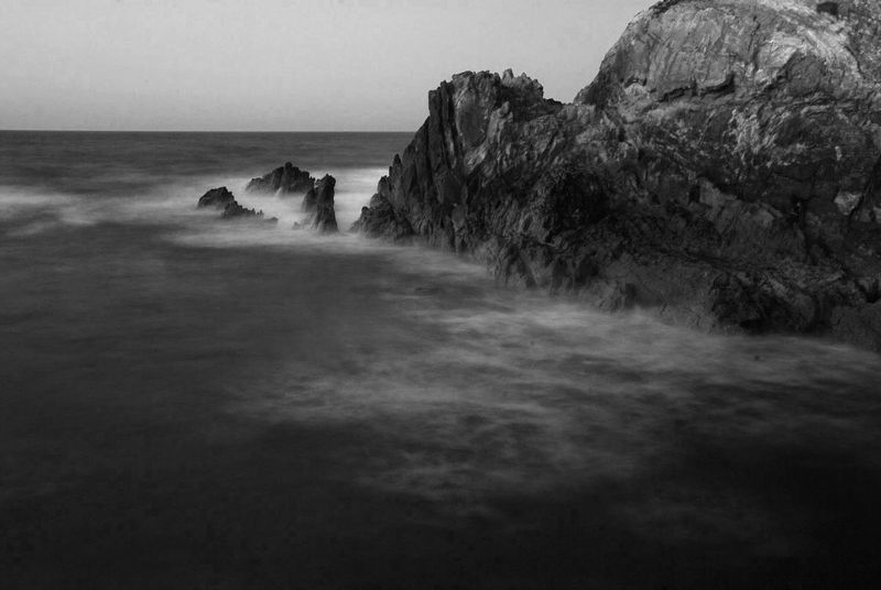 Beauty In Nature Blackandwhite Coastline Horizon Over Water Landscape Landscapes With WhiteWall Long Exposure Monochrome Rock Formation Scenics Sea Silk Effect The KIOMI Collection Tranquil Scene Tranquility Water Showcase April The Great Outdoors With Adobe Fine Art Photography Monochrome Photography Black And White Friday