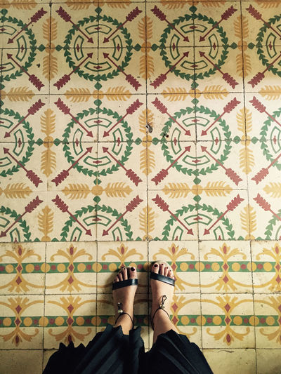 Black Casual Clothing Ceramics Design Feet Floor From Above  Green Color Old Buildings Pattern Personal Perspective Sandals Standing Tile Tourist