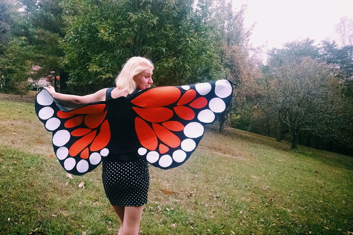 Tree Standing Grass Full Length Day Person Outdoors Halloween Costume Wings Butterfly Monarch Orange Halloween Costumes Girl Woman Blonde Quirky College Girl