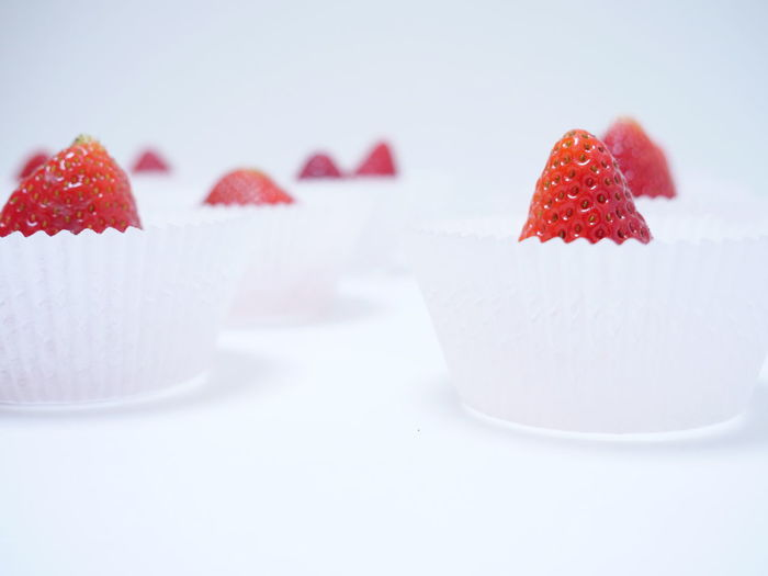 Close-up of strawberry cake against white background
