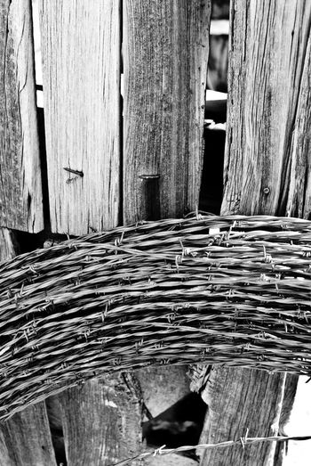 """Barbed Coil"" An unused coil of barbedwire sits idle against an abandoned old house in the Village of Corona, New Mexico, USA. Barbedwire Barbed Wire RuralExploration Ruraldecay Abandoned Buildings Abandoned Places Blackandwhite Photography Blackandwhite Black And White"
