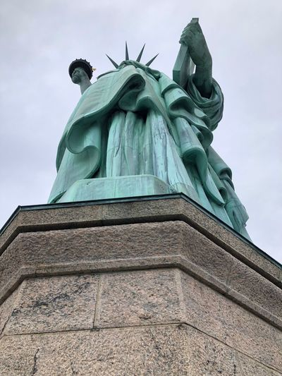 National Parks Service Statue of Liberty. Statue Female Likeness Low Angle View Human Representation Travel Destinations Built Structure Liberty Liberty Island Libertystatue  Liberty Style Statue Of Liberty Statues And Monuments