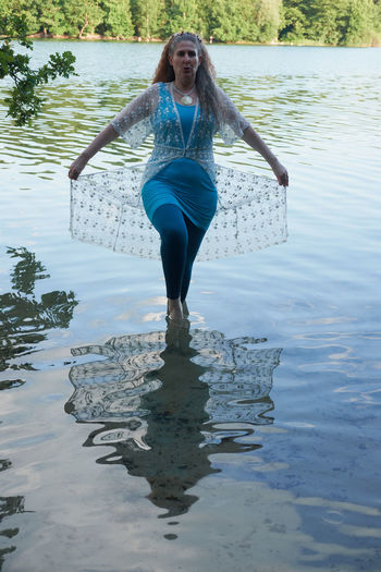 Full length of woman standing in water