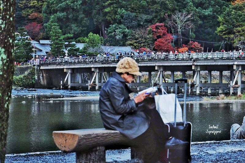 Reading book Book Reading Vacations Traveling Autumn🍁🍁🍁 Riverside Bridge Outdoors Japan Streetphotography Fujifilm Fujixa1 Landscape Cold Temperature