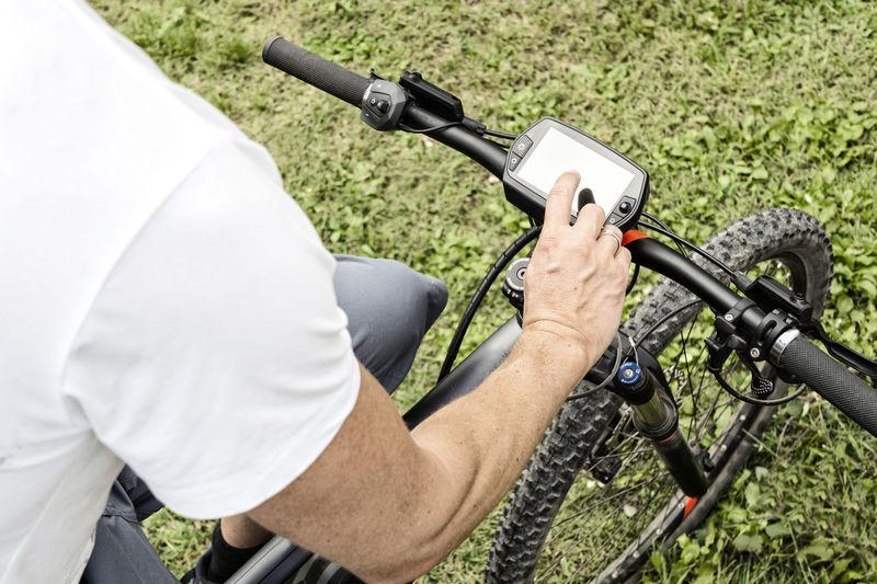 Men using gps device on a mountain bike