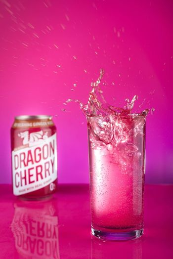 🐉 Brigford Indoors  Pink Color Food And Drink Colored Background No People Household Equipment Splashing Text Motion Refreshment Glass - Material Studio Shot Freshness Close-up Drinking Glass Glass Container Communication Purple Table