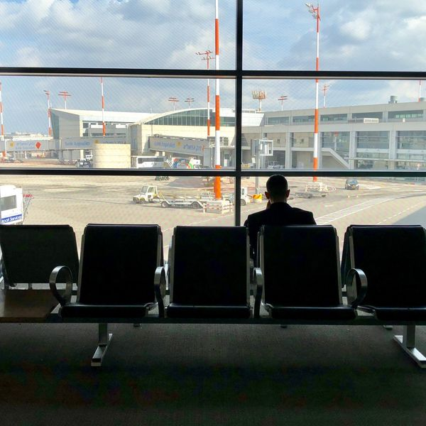 Airport Real People Airport Travel Transportation Architecture Built Structure Railing Men Airport Departure Area Airplane One Person