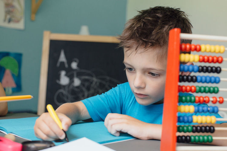 Portrait Of Boy Doing Homework
