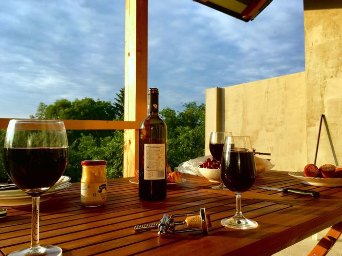 Late evening EyeEmNewHere Alcohol Refreshment Drink Wine Food And Drink Glass Wineglass Drinking Glass Sky Bottle No People Cloud - Sky Freshness Food