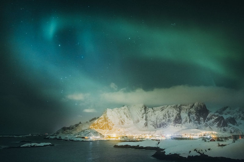 Panoramic view of sea against sky at night