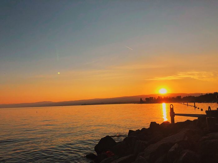 Lac Léman Lausanne EyeEmNewHere EyeEm Best Shots Switzerland Water Sky Sunset Scenics - Nature Beauty In Nature Sea Tranquility Orange Color Tranquil Scene Idyllic Beach Nature Reflection Sun Land Sunlight Non-urban Scene Silhouette Horizon Outdoors