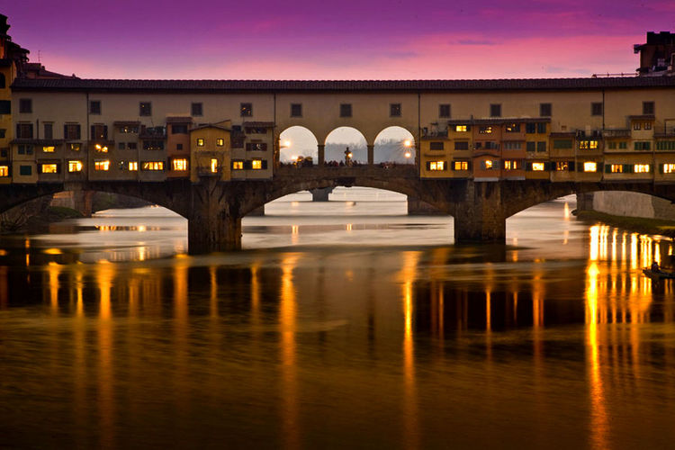 Fiume Arno, Ponte Vecchio al tramonto.. Firenze Gold Italia Tramonto Travel Travel Photography Arch Architecture Bridge - Man Made Structure Building Exterior Built Structure City Florence Italy No People Pink Color Pontevecchio Reflection River Sky Sunset Travel Destinations Travelphotography