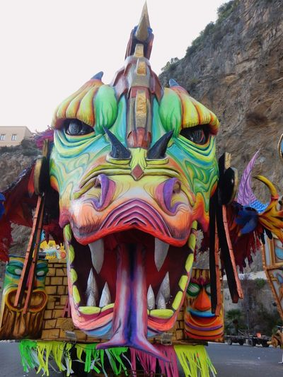 Maiori, Campania, Italy - March 4, 2019: Allegorical floats in the square of the port for the 46th edition of the Grand Carnival of Maiori Italy Campania Salerno Italy Grand Carnival Of Maiori Amalfi Coast Colorful Floats Carnival - Celebration Event Allegorical Floats Maiori, Day Art And Craft Representation Creativity Sculpture Multi Colored No People Statue Sky Human Representation Craft Belief Outdoors Ornate Carving