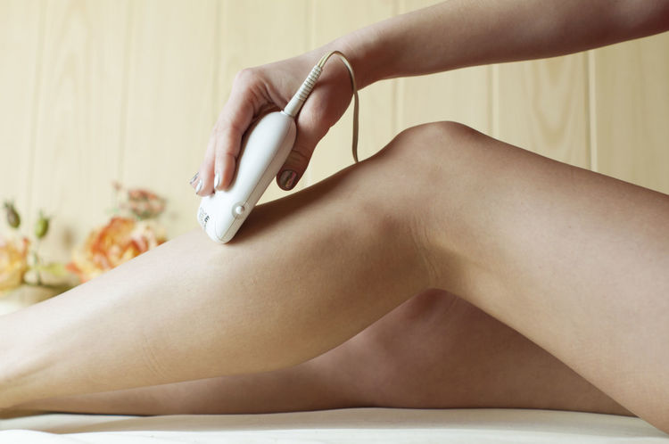 Appliance Beauty Body Care Depilation Hair Removal Leggings Body Care Epilator Epilator, Hair Removal, Hair Removal, Depilation, Legs, Human Body Part Human Hand Human Leg Legs Lifestyles Luxury One Person Real People Salon Sitting Skin Women Young Adult