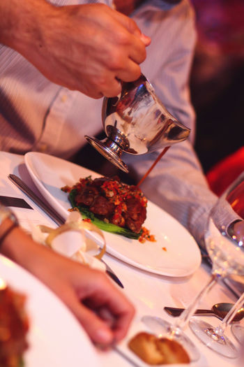 Celebration Dining Dinner Drink Eating Utensil Food Food And Drink Food Serving Freshness Glass Group Of People Hand Holding Human Body Part Human Hand Indoors  Kitchen Utensil Meal Men Plate Real People Restaurant Selective Focus Table