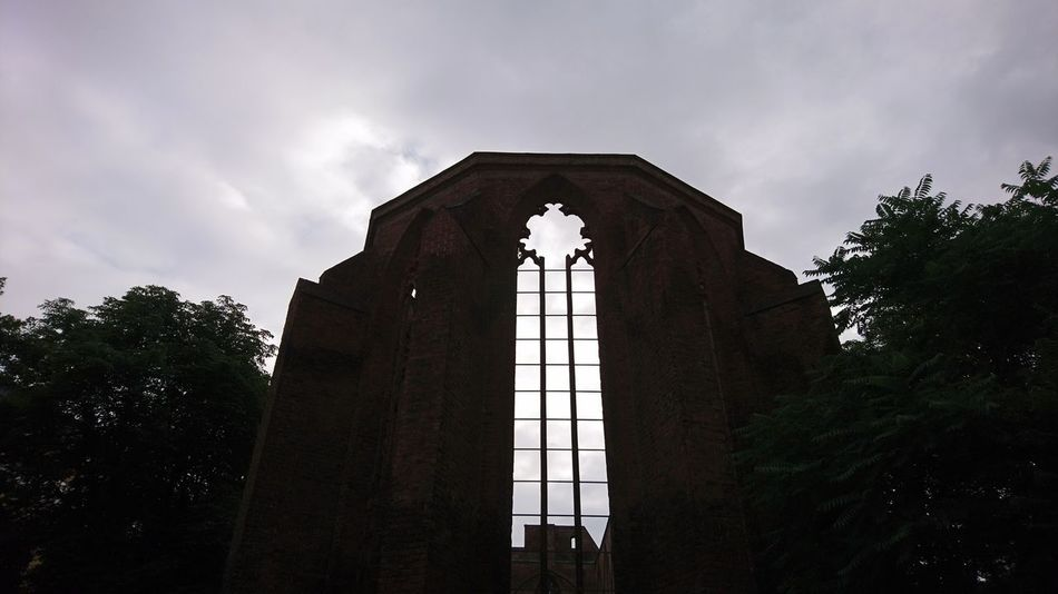 Church ruin. Berlin Germany B Capital B Church Ruin Ruined WWII History Culture Religion Silhouette Architecture Clouds Clouds And Sky Dramatic Rungs Window Spirituality Urban Landscape Tree Politics And Government City Architecture Sky Built Structure Building Exterior