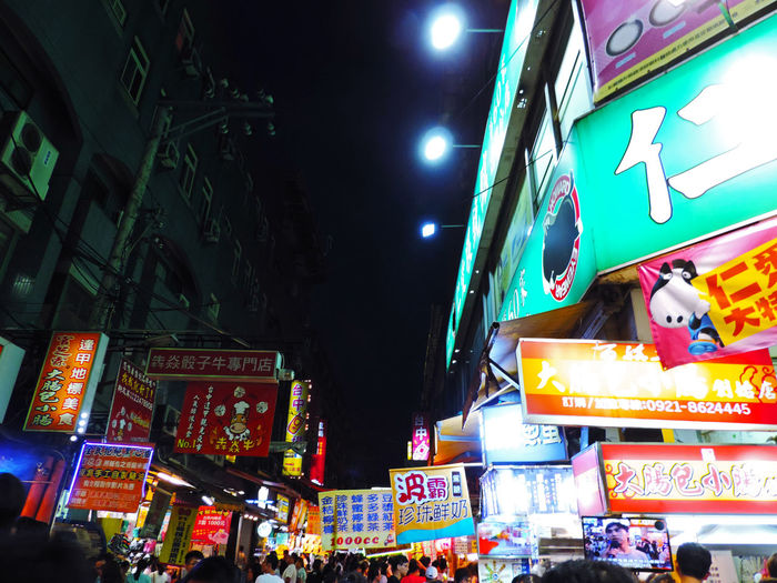 Low angle view of illuminated street at night