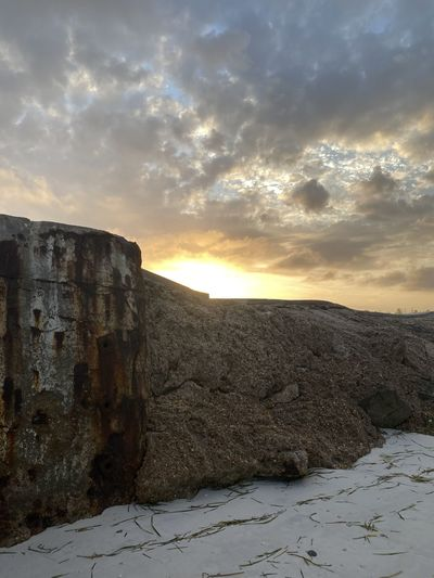 Scenic view of rocky landscape against sky during sunset