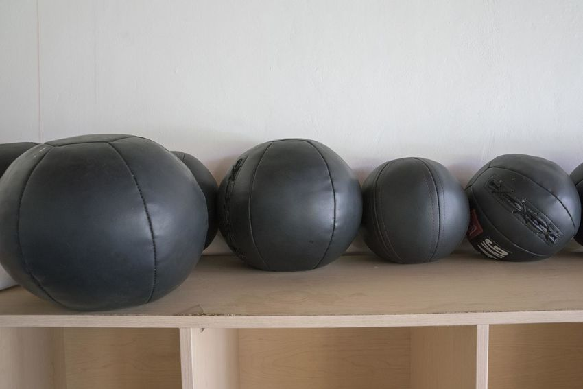 View of medical balls used in a school gym. Gym Gym Equipment Weight Ball Black Color Indoors  Still Life No People Side By Side Close-up Sports Equipment Gray Day Sphere Sport