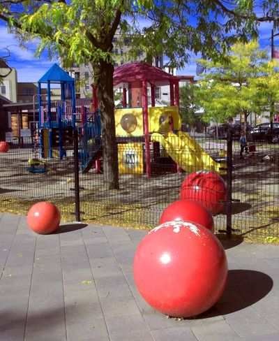 Playground in the city park. Built Structure City Close-up Colorful Day Empty Playground Empty Playgrounds Kids Playground No Kids No People Outdoors Park Playground Playground Equipment Playground Slide Playground Structure Playgrounds Recreation  Recreational Area Red Tree Yellow