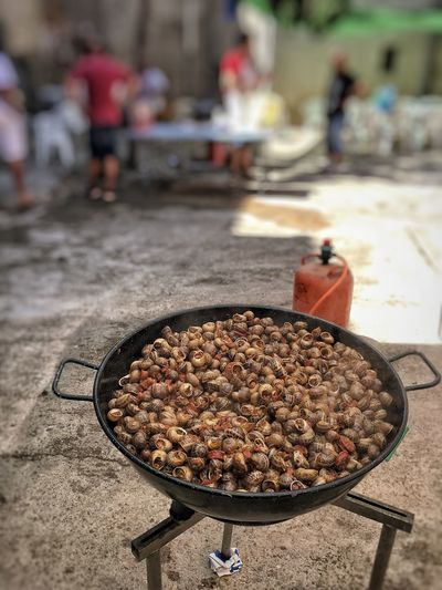 Focus On Foreground Food Food And Drink Real People Outdoors Freshness Day Snail Snails Rural Scene Mediterranean Food Popular Foods