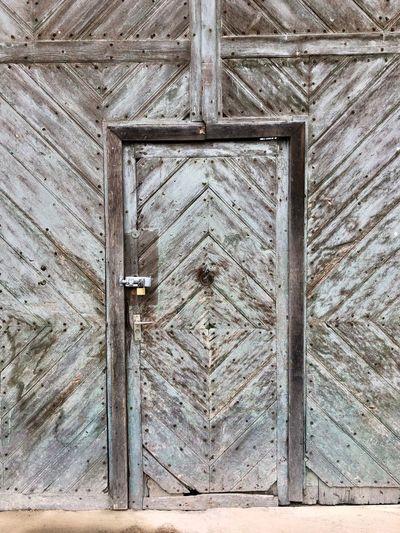 Full frame shot of old wooden door of house