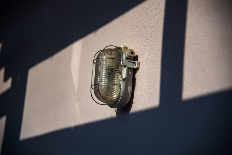 High angle view of electric lamp on wall