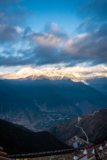 Mountain Cloud - Sky Sky Mountain Range Beauty In Nature Scenics - Nature Environment Nature Landscape Tranquil Scene Tranquility Non-urban Scene Incidental People Day Outdoors Architecture Snow Winter People Snowcapped Mountain Mountain Peak Meili DeQin Yunnan China Tibet Top High Fog Cool Cold